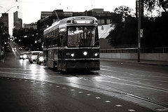 Training Car (Js) Tags: street bridge blackandwhite bw reflection film 35mm track dof bokeh iso400 ttc 85mm fm10 streetcar kodakbw400cn uphill 135mm queenstreeteast 85mmf18d hbw trainingcar