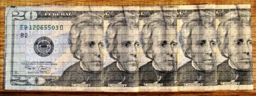 five U.S. twenty dollar bills