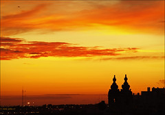 urban sunset 2 (julioc.) Tags: sunset red urban orange portugal beautiful buildings dark airplane faro topf50 skies cityscape quality towers scenic silhouettes copyspace algarve atmospheric e510 bigmomma j100 julioc supershot religiousstructure cy2 challengeyouwinner 3waychallenge mywinners abigfave favemegroup6 photographybyjulioctheblog olympuse510 a3b ilustrarportugal pfogold srieouro damniwishidtakenthat