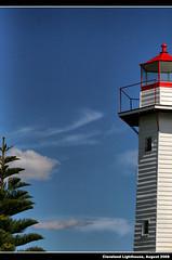 Cleveland Lighthouse ([ Kane ]) Tags: blue light red sky lighthouse tree clouds cleveland brisbane qld kane gledhill oldlighthouse 400d kanegledhill kanegledhillphotography