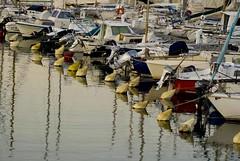 buoys (miss_kcc) Tags: france water marina reflections boats harbour sete buoys buoyant