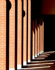 brick arcade in light and shadow (pannaphotos) Tags: shadow brick searchthebest arcade architettura luce portico lightr linee mattoni omb proiezione geometriara pannaphotos