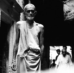 Man in alley, Varanasi. (ndnbrunei) Tags: blackandwhite bw india 120 6x6 tlr film rollei rolleiflex mediumformat square kodak bn varanasi mf rolleiflex28f 50faves classicblackwhite 25faves autaut rolleigallery ndnbrunei kodak400tmy2