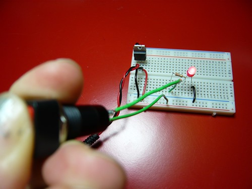 Pressing the switch to light the LED