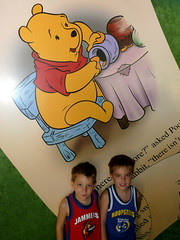 Aaron & Seth in front of Pooh Mural in line for the Adventures of Winnie the Pooh attraction in Magic Kingdom (darling1s) Tags: vacation seth aaron disney 2008 magickingdom