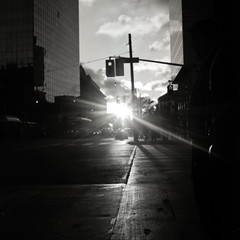 Sundown (Js) Tags: street light sky people blackandwhite bw sun toronto 6x6 clouds buildings dark square shadows dof darkness traffic sundown kodak flare intersection collegest yashica tmax100 universityave mat124g ddx ilfotec 100tmy