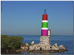 Rainbow lighthouse.. (iCamPix.Net) Tags: lighthouse explore fav favourite soe floridakeys mostviewed cubism canonef70200mmf28lis supershot floridastateparks ultimateshot mostwatched cannoneos1dsmarkiii icampixtechnology islamoradalighthouse islamoradamarina rainbowlighthouse