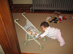Aki playing with baby doll