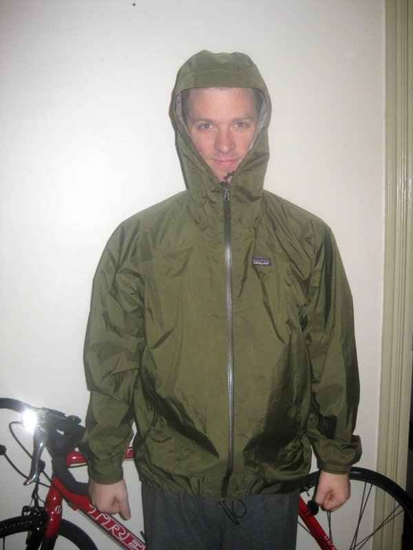 Kyle wears a rainjacket