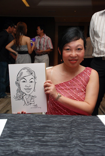 Caricature live sketching for Ezra Holdings 4