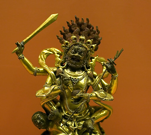 Hindu god brandishing a sword