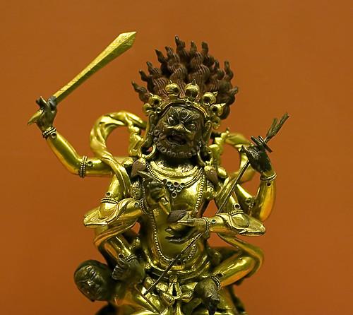 Hindu god brandishing a sword