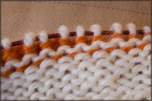welt is closed and live stitches are again original fabric (white yarn)