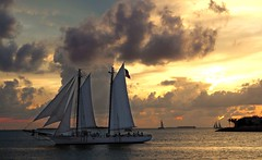 Sailing in the sunset (Madiash) Tags: sunset sea orange usa clouds landscape sailing florida keywest digitalcameraclub lpsky fotocompetition|fotocompetitionbronze