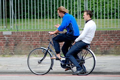 Two on a bike (Michiel2005) Tags: man men bike bicycle jeans gazelle slippers fiets mannen jongen jongens passagier bagagedrager rijwiel lecoqsportive