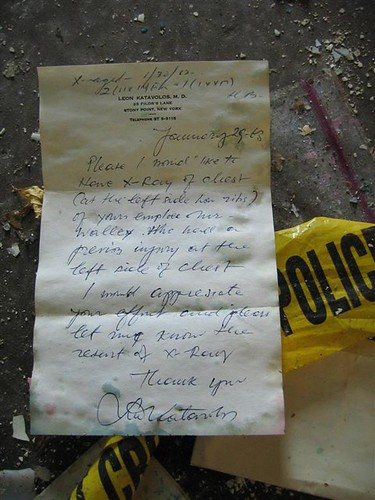 Discarded note amidst police debris