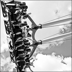 On a Ride (R A Pyke (SweRon)) Tags: park people blackandwhite bw men gteborg amusement women sitting ride gothenburg olympus swing liseberg sit seated e410 sweron