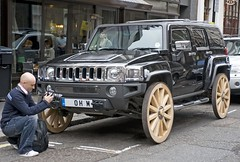 hummer sitting on wagon wheels