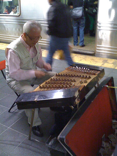 Chinese dulcimer player