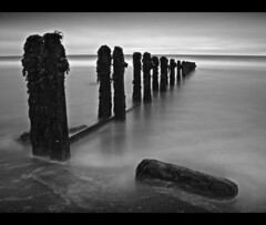 Sandsend Groynes (Antony....) Tags: longexposure sea seascape beach rock landscape geotagged sand whitby zuiko northyorkshire groynes sandsend 1415mm ndx10 aplusphoto 282seconds geo:lat=5450262 geo:lon=0670027