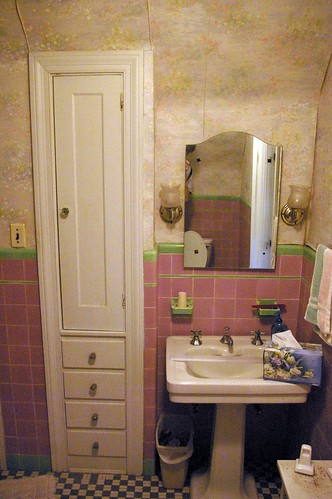 Pink and green tile bathroom