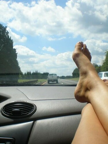 and its, two bare feet on the dashboard...