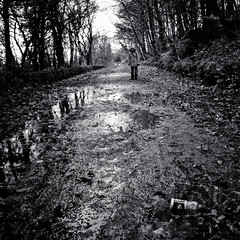 A pathway, a human, and a plastic bottle of lucozade (SurfaceSpotting) Tags: uk people blackandwhite bw square blackwhite bottle nikon peakdistrict sheffield plastic human reflexion muddy pathway lucozade rivelin dams southyorkshire d40 michaelides visiongroup d40x rivelindams surfacespotting georgemichaelides
