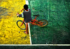 Letting Go Of The Wheel (maraculio) Tags: white green art bicycle wheel basketball yellow festival court hit child go line thursday 31st angono imago letting virgie artphoto the msv higantes of imago2007 imagoism maraculio happyimagoismthursday