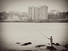 Fishing (Raveesh Vyas) Tags: park sea people india man buildings garden fishing explore bombay mumbai mws sagar colaba upvan busysunday