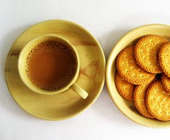 Tea time...and some biscuits too.. (p o o m b a t t a) Tags: cup marie canon evening tea drink biscuits product teatime chai chaya saucer arrowroot ixy poombatta