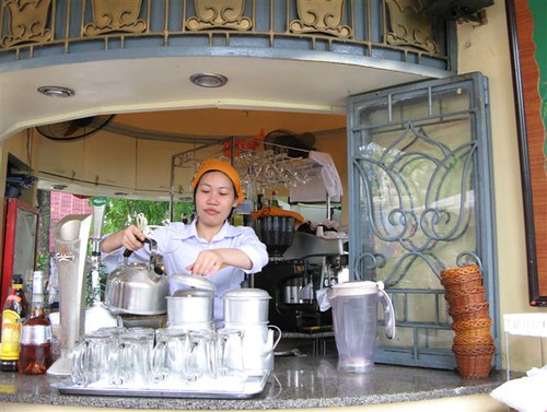 Vietnamese woman making coffee