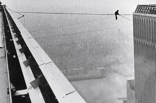 Philippe Petit walks wire Twin Towers