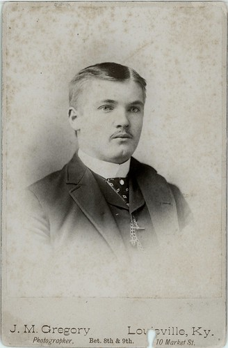 Man with moustache, collar and tie