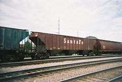 A former Atchinson, Topeka & Santa Fe covered hopper in pre 1995 markings. Franklin Park Illinois. May 2008.