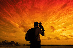 guess who?? (chospatis) Tags: sunset sky sun clouds canon addo photographe