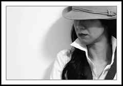 portrait (vengeance) (fateless_gypsy) Tags: shadow portrait bw woman white girl hat lady female asian expression profile attitude fedora onwhite