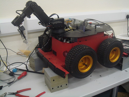 Mobile Robots Pioneer 3-AT during sample collection tests with the arm