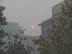 sun-breaking-through-the-beijing-sky