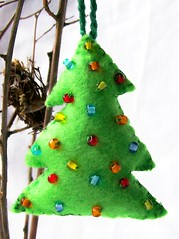 ChristmasTree ornie (Beyond.the.Box) Tags: christmaslights encrusted holidayornament multicoloredlights treeshaped multicoloredglassbeads brightgreenfelthandstitchedembroideredbeadedbuttonschristmasornamentschristmastreedecorationsholidayshandcraftedhandsewnthinkoutsidetheboxthinkoutsidethebox2008