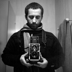Kid with a new toy (Un-exposed) Tags: winter mamiya self bathroom mirror hp5 outdated 80mm c330