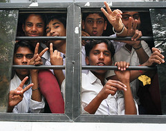 School Boys, Delhi (Mark William Brunner) Tags: india bus 20d boys canon children hope hands bars peace faces delhi smiles schoolkids peacesign indiagate indianchildren theunforgettablepictures peacefulchildren markbrunner indiaportraitsstreet markwilliambrunner indianpeace thepeacebus