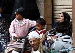 Faces (doublejeopardy) Tags: woman man face canon egypt bazaar luxor souq ef24105mmf4lis