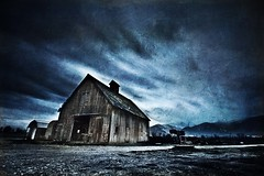 Montana barn at dawn (Jeff Engelhardt) Tags: november blue cloud storm motion blur detail green texture clouds barn contrast race canon dark timelapse montana moody wind decay sinister cyan evil timeexposure missoula shack 24mm drama ghostly ndfilter gndfilter stevensville bitterrootvalley f14l 40d