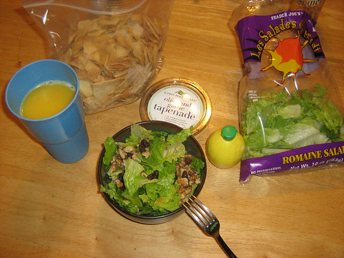 Salad, pita chips, and tapenade