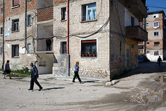 Street scene - Berati, Albania (Maciej Dakowicz) Tags: street city people man architecture person europe bricks neglected communist communism socialist block balkans dailylife albania residential socialism berat berati