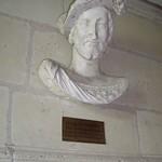 Chambord. Bust of King Francis I attached to a calcareous stone wall