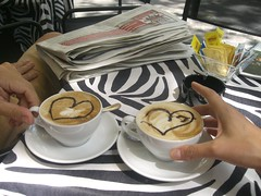 coffee for two (klli tomingas) Tags: summer brown white black cup coffee yellow newspaper pattern hand heart plate zebra cappuccino