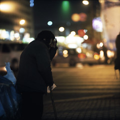 the collector (memetic) Tags: china street urban woman 120 6x6 night mediumformat lights downtown fuji bokeh tl chinese  nanjing provia jiangsu  p6 pentaconsix sonnar 180mm  400x
