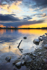 Sticks and stones.. (Nina_999) Tags: sunset sky lake water clouds canon finland sticks rocks sundown stones eos20d themoulinrouge firstquality flickrsbest abigfave theperfectphotographer multimegashot