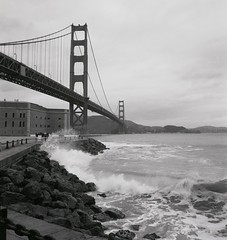 Storm Waves at Golden Gate Bridge #1 (wanderingYew2 (thanks for 5M+ views!)) Tags: sanfrancisco california bridge blackandwhite storm mamiya film mediumformat waves goldengatebridge fortpoint sanfranciscobay presidio blackdiamond us101 filmscan winterstorm alfredhitchcock pacificcoasthighway californiahighway1 ca1 blackandwhitefilm mamiya7ii nationalscenicbyway allamericanroad blackwhiteaward unitedstateshighway101 vertigofilminglocation